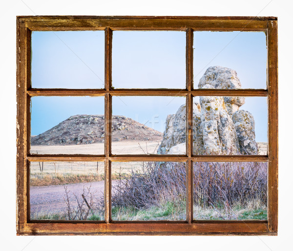prairie with rocks and butte window view Stock photo © PixelsAway