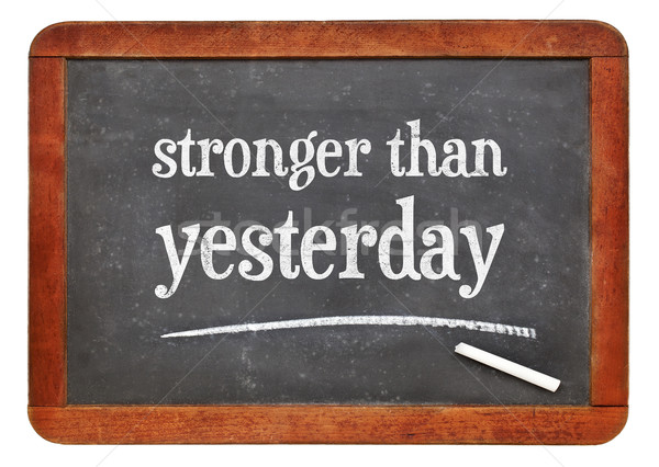 stronger than yesterday text on blackboard Stock photo © PixelsAway