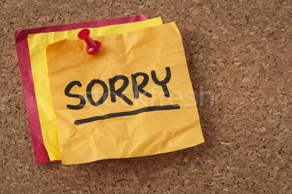 Stock photo: sorry - apology on sticky note