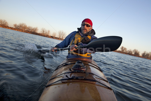 paddling workout in a sea kayak Stock photo © PixelsAway