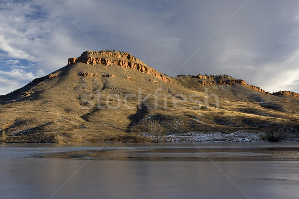 hills, sandstone cliffs and freezing lake in Colorado Stock photo © PixelsAway