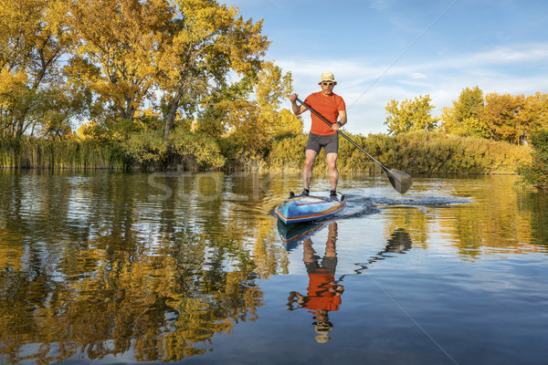 stand up paddling in fall colors Stock photo © PixelsAway
