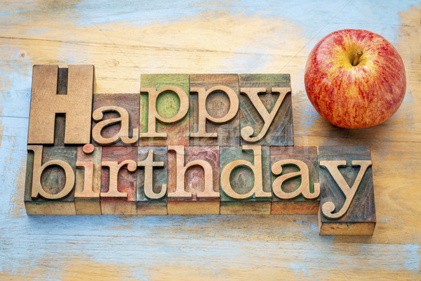 Stock photo: Happy Birthday in wood type with apple