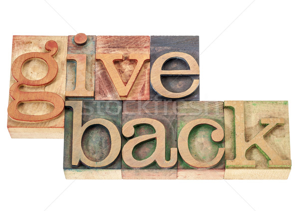 give back words in wood type Stock photo © PixelsAway