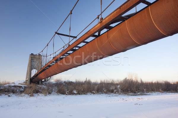 rusty flume suspended over a river Stock photo © PixelsAway