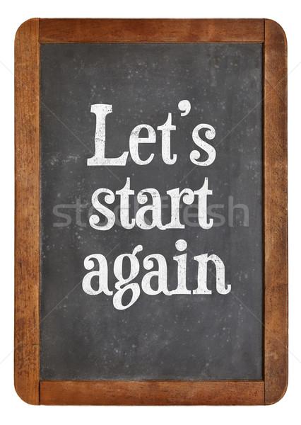 Stock photo: Let us start again on blackboard