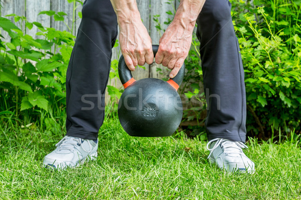 kettlebell workout in backyard Stock photo © PixelsAway