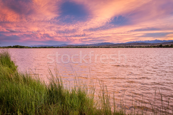 pink sunset cloudscape over lake Stock photo © PixelsAway