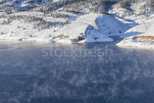 fog over mountain lake Stock photo © PixelsAway
