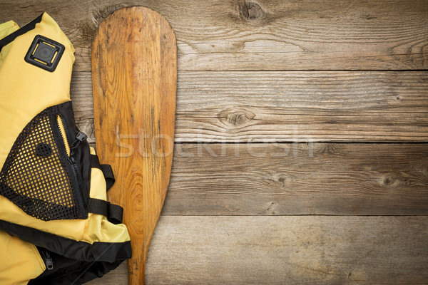 canoe paddle and life jacket Stock photo © PixelsAway