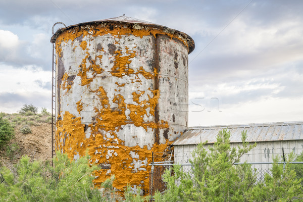 old water tank covered by lichen Stock photo © PixelsAway
