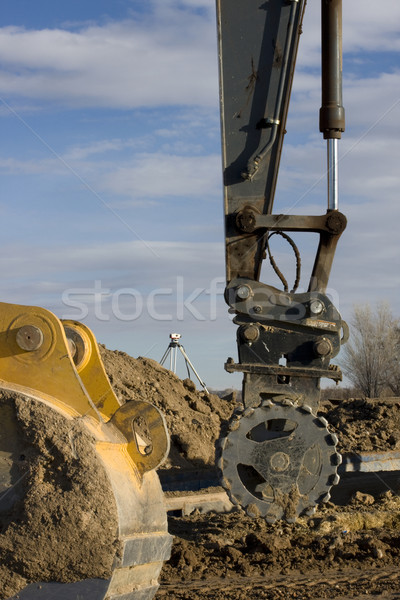 Road construction - excavator arm with roller, backhoe scoop, su Stock photo © PixelsAway
