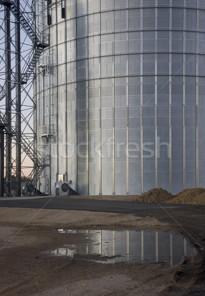 newly constructed metal grain silo with water reflection Stock photo © PixelsAway