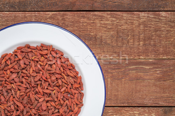 dried goji berries in a white plate Stock photo © PixelsAway