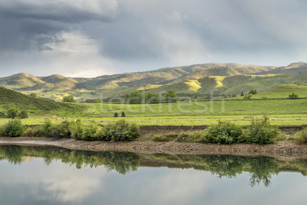 lake and green meadows at  foothills Stock photo © PixelsAway