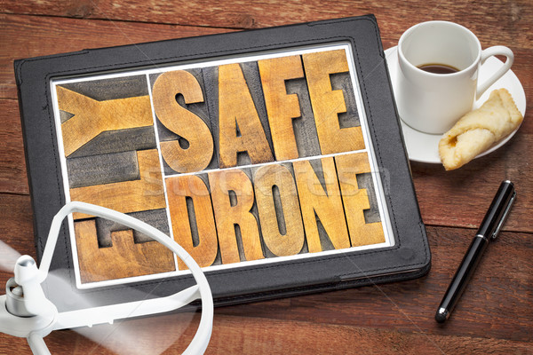 fly safe drone word abstract on digital tablet Stock photo © PixelsAway