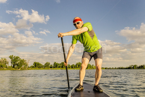 stand up paddling on lake in Colorado Stock photo © PixelsAway