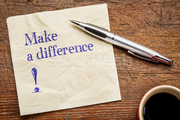 Make a difference text on napkin Stock photo © PixelsAway