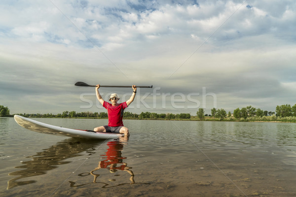 senior paddler on stand up paddleboard Stock photo © PixelsAway