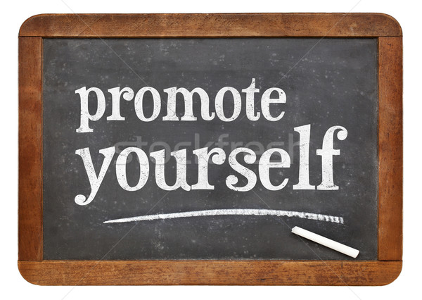 promote yourself blackboard sign Stock photo © PixelsAway