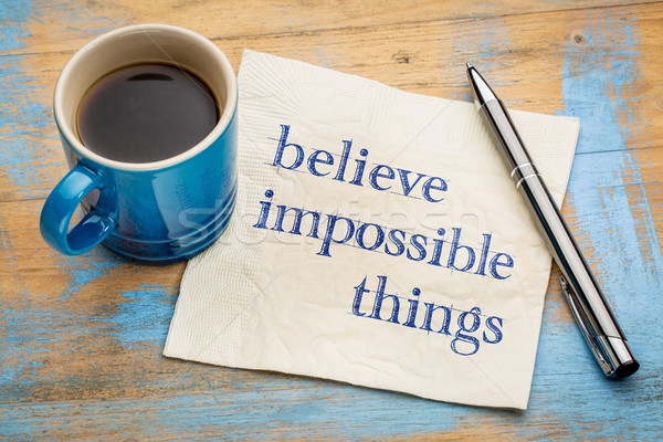 Believe impossible things text on napkin Stock photo © PixelsAway