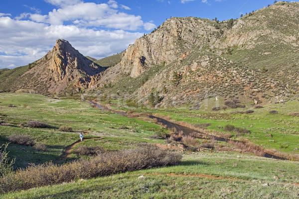 hiker in mountain scenery Stock photo © PixelsAway
