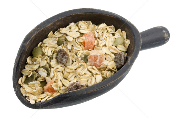 scoop of muesli cereal with papaya, pepitas and raisins Stock photo © PixelsAway