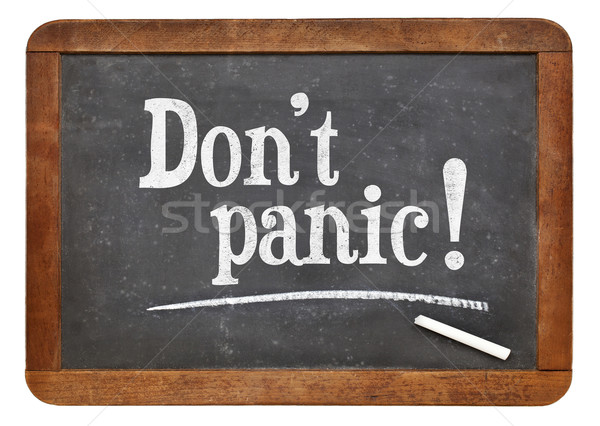 Do not panic - text on blackboard Stock photo © PixelsAway