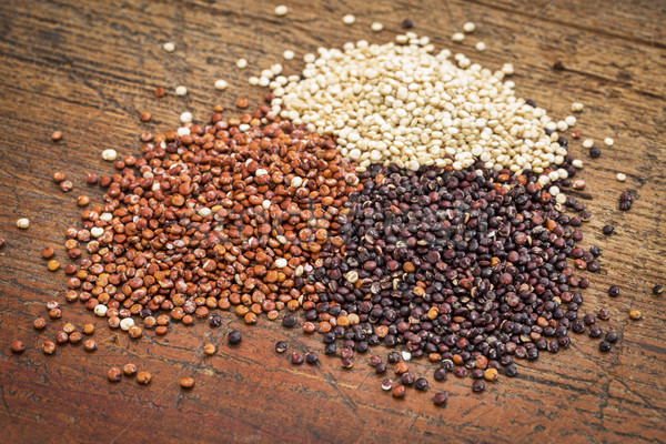 red, white and black guinoa grain on a grunge wood surface Stock photo © PixelsAway