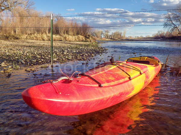 kayak and fence across river Stock photo © PixelsAway