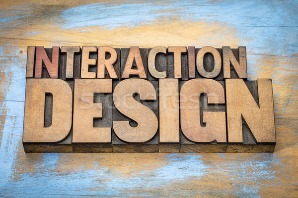 interaction design word abstract in wood type Stock photo © PixelsAway