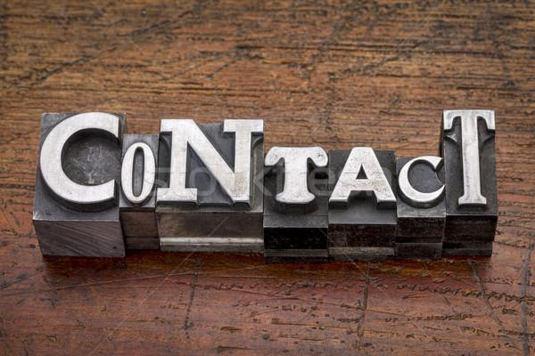 contact word in metal type Stock photo © PixelsAway