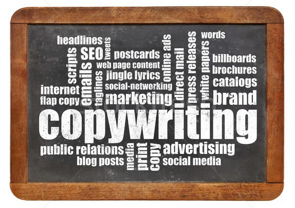 copywriting word cloud on blackboard Stock photo © PixelsAway