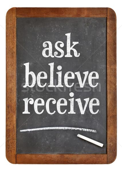 Ask, believe, receive on blackboard Stock photo © PixelsAway