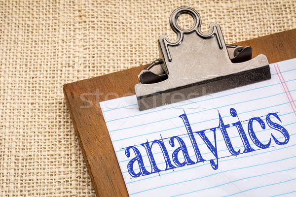 analytics word on clipboard Stock photo © PixelsAway