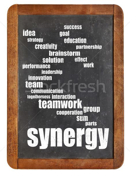 synergy word cloud on blackboard Stock photo © PixelsAway
