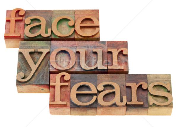 face your fears phrase in letterpress type Stock photo © PixelsAway