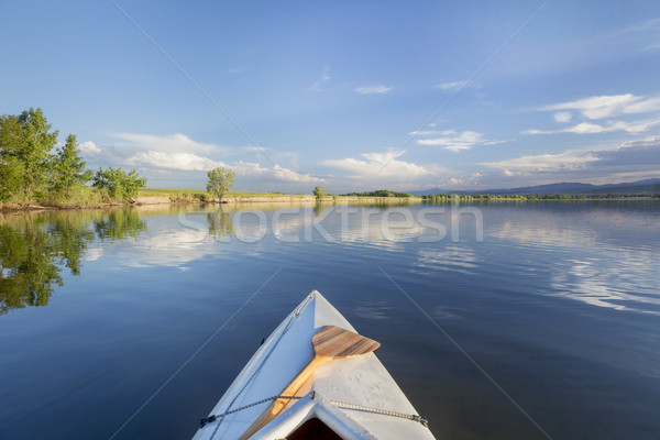 summer canoe paddling on lake Stock photo © PixelsAway