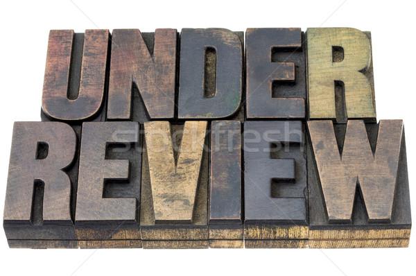 under review in wood type Stock photo © PixelsAway
