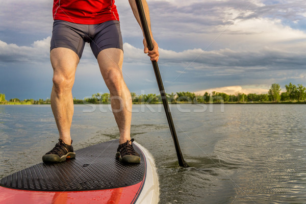 stand up paddling on lake Stock photo © PixelsAway