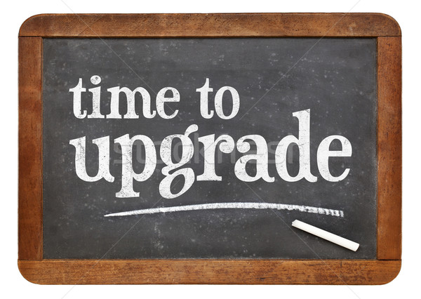 Time to upgrade reminder on blackboard Stock photo © PixelsAway