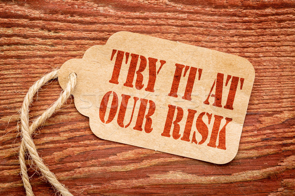 Try it at our risk on price tag Stock photo © PixelsAway