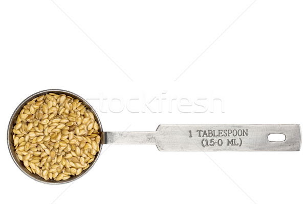golden flax seeds in a tablespoon in a tablespoon Stock photo © PixelsAway