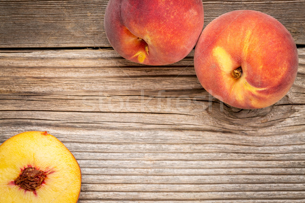 peach fruits on weathered wood Stock photo © PixelsAway