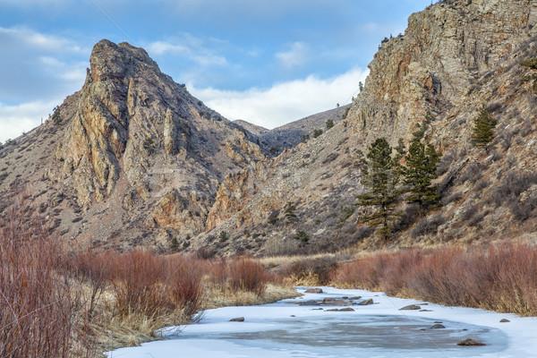 frozen stream and landmark rock Stock photo © PixelsAway