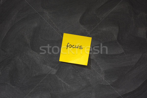 focus on yellow sticky note against blackboard Stock photo © PixelsAway