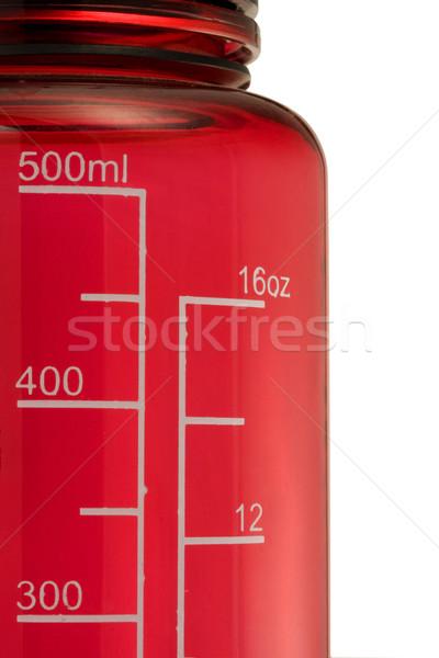 Raddoppiare scala fluido bere bottiglia rosso Foto d'archivio © PixelsAway