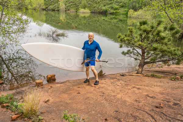 senior paddler with SUP paddleboard Stock photo © PixelsAway