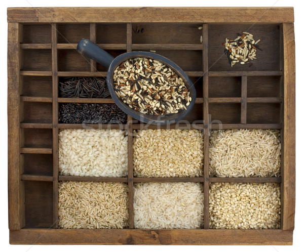 variety of rice grains in vintage wooden drawer with scoop Stock photo © PixelsAway