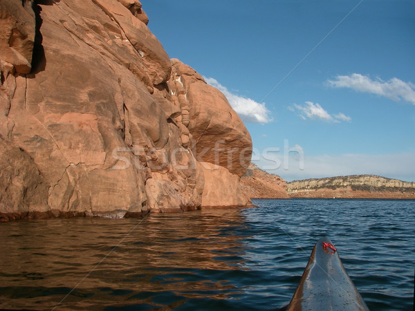 paddling kayak on a lake with redstone cliffs Stock photo © PixelsAway
